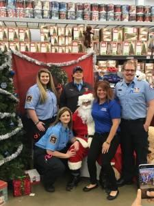 Sheriff's Office staff sitting on Santa's lap