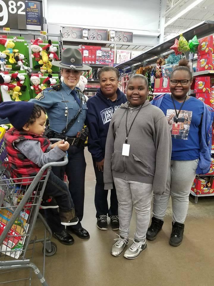 Law Enforcement officer shopping with a family in Walmart