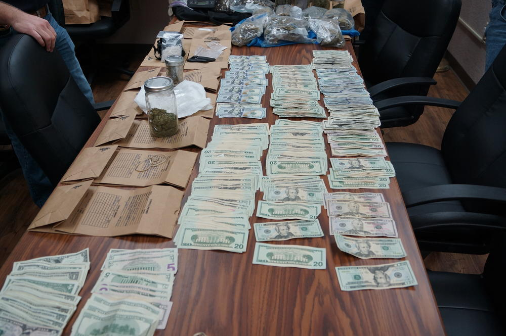 Confiscated Marijuana, cash, and ICE